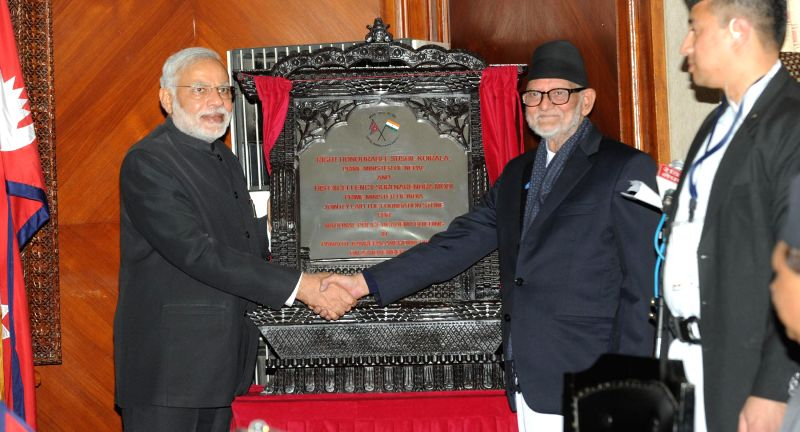 Prime Minister Narendra Modi with the Prime Minister of Nepal Sushil Koirala during a programme organised to lay the foundation stone of Police Academy, in Kathmandu, Nepal, on Nov 25, ... - Narendra Modi