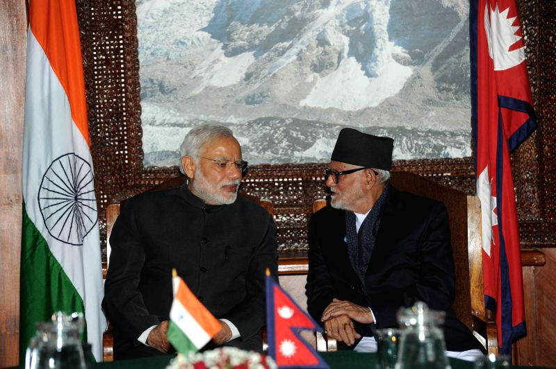 Prime Minister Narendra Modi with the Prime Minister of Nepal Sushil Koirala ahead of signing of agreements between the two nations in Kathmandu, Nepal, on Nov 25, 2014. - Narendra Modi