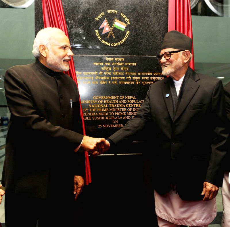 Prime Minister Narendra Modi with the Prime Minister of Nepal Sushil Koirala at the official handover and inauguration ceremony of the National Trauma Centre, in Kathmandu, Nepal on Nov ... - Narendra Modi