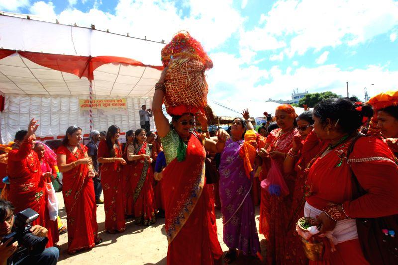 Women from Far Western Nepal dance during the celebration of Gaura Parva festival in Tundikhel of Kathmandu, Nepal, Sept. 2, 2014. The Gaura festival is mostly ...