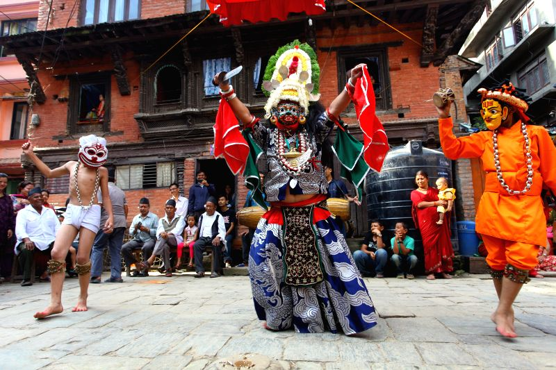 """Masked dancers perform as part of """"Devi Pyankha"""" (Devi Dance) to mark the beginning of Indrajatra Festival in Kathmandu, Nepal, Sept. 3, 2014. Nepalese ."""