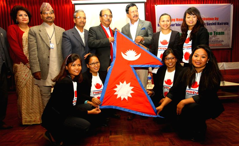Seven Summits Women Team receive the Nepali national flag from lawmakers of Constituent Assembly before their expedition to Mount Vinson Massif in Antarctica during a farewell and flag ...