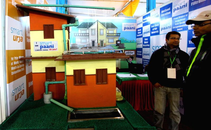 Visitors look at products at a stall during the Nepal Construction Expo 2014 at Bhrikutimandap in Kathmandu, Nepal, Dec. 5, 2014. The five-day expo which organized to promote the ...