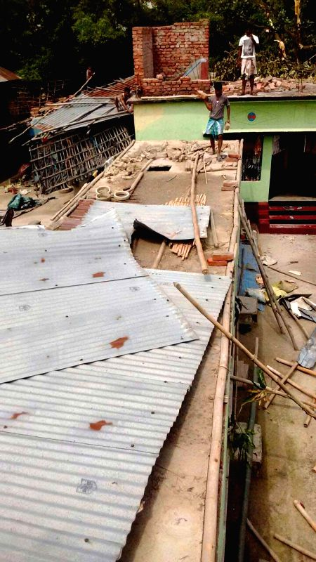 Destruction caused by a storm that lashed several districts of Bihar late on Tuesday night (22nd April 2015) in Katihar on April 23, 2015. At least 32 people have been killed and around 100 ...