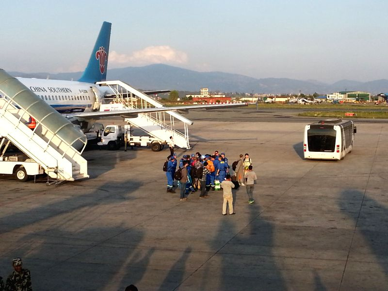 Members of Blue Sky Rescue Team, a Chinese civilian rescue team, arrive at the airport of Katmandu, Nepal, April 27, 2015.