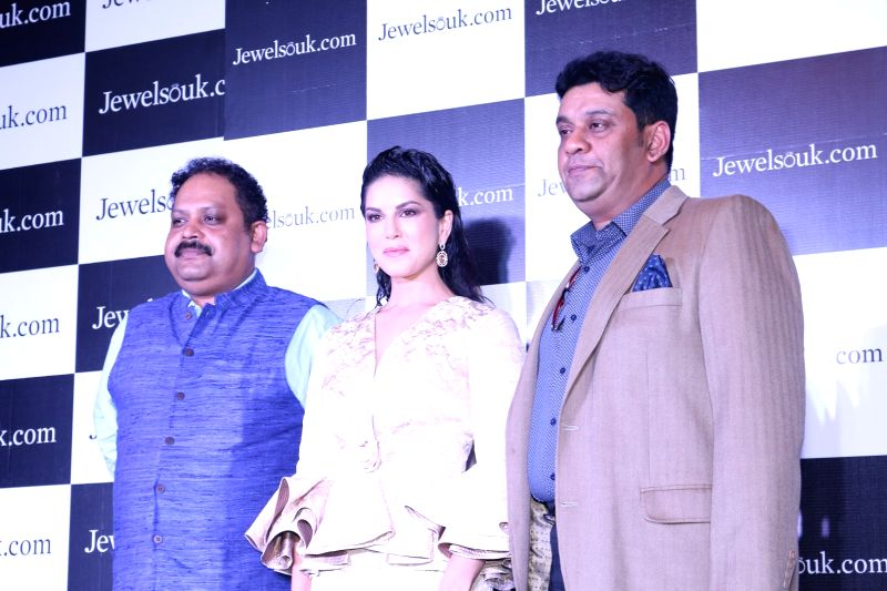 Kaushik Mukherjee, CEO, Jewelsouk, actress Sunny Leone and Saurav Bhattacharya, President, Jewelsouk during the launch of online jewellery store, Jewelsouk, new Television commercial in ... - Sunny Leone and Kaushik Mukherjee
