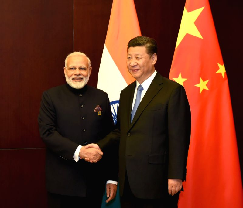 Kazakhstan (Astana): Prime Minister Narendra Modi meets the President of the People`s Republic of China, Xi Jinping, on the sidelines of the SCO Summit, in Astana, Kazakhstan on June 09, 2017. - Narendra Modi
