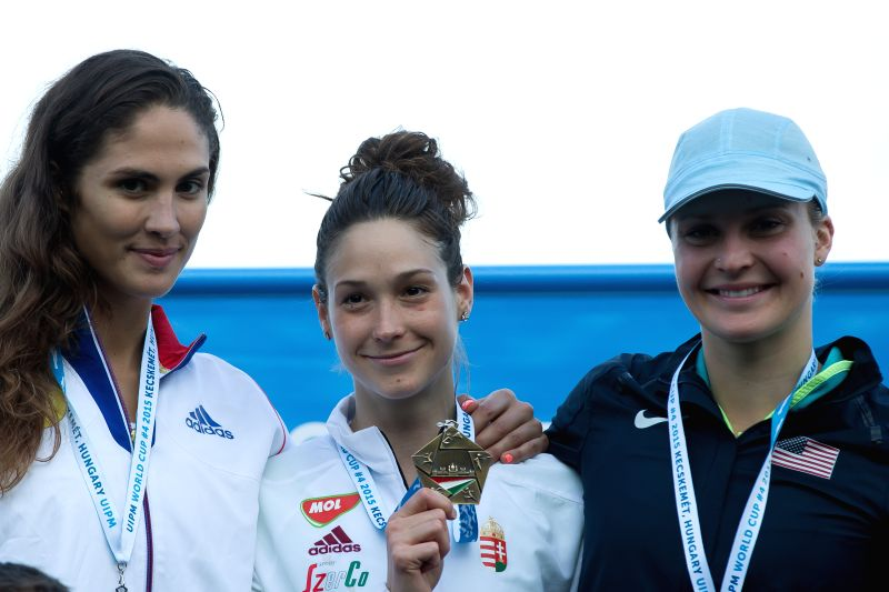 Gold medalist Zsofia Foldhazi (C) of Hungary, silver medalist Elodie Clouvel (L) of France and bronze medalist Margaux Isaksen of the United States pose for ...