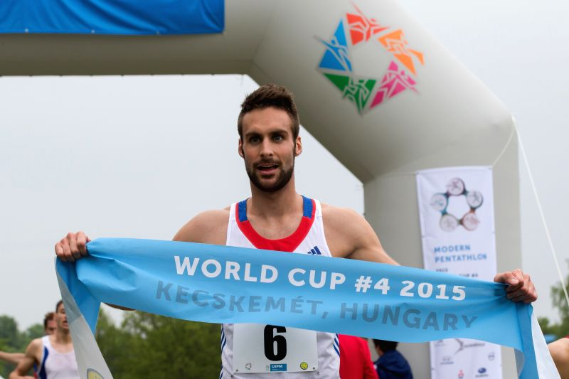 Valentin Belaud of France celebrates after winning the men's modern pentathlon World Cup in Kecskemet, Hungary, on May 3, 2015.