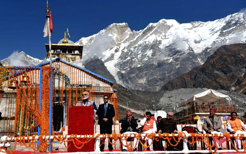 :Kedarnath: Prime Minister Narendra Modi addresses a public meeting at Kedarnath in Uttarakhand on Oct 20, 2017. Also seen Uttarakhand Governor Dr. KK Paul, Chief Minister Trivendra Singh Rawat and ...