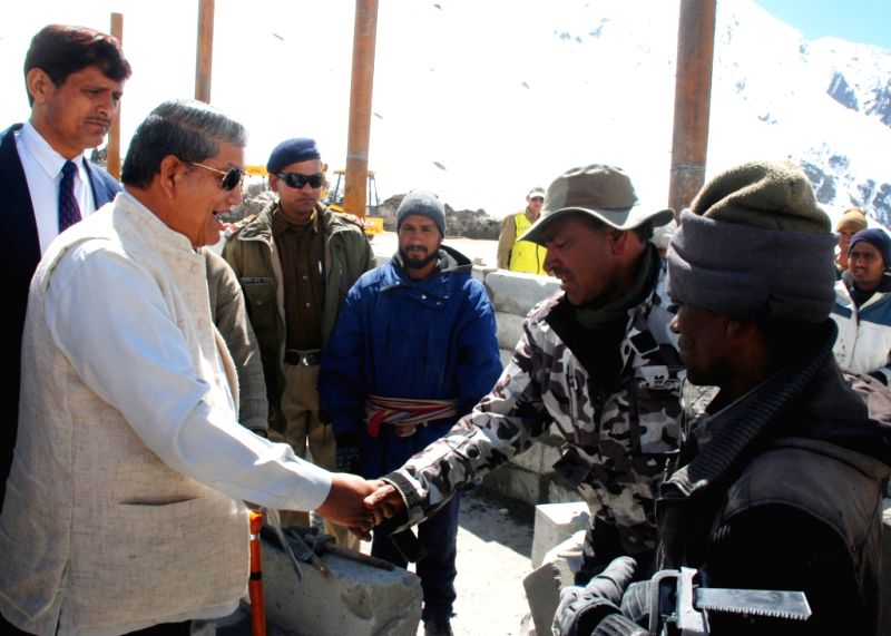 Uttarakhand Chief Minister Harish Rawat meets with the workers of Nehru Institute of Mountaineering (NIM) during his visit of Kedarnath, on April 18, 2015. - Harish Rawat