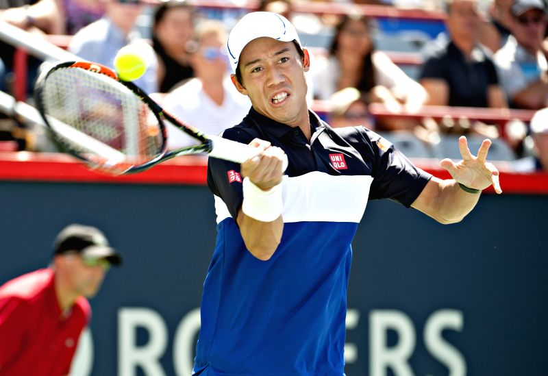 Kei Nishikori of Japan returns the ball against Pablo Andujar of Spain during the men's singles match at Rogers Cup tennis tournament, in Montreal, Canada, Aug. ...