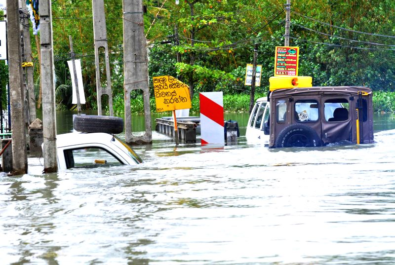 KELANIYA, May 21, 2016 - Photo taken on May 20, 2016 shows vehicles drown by floods in Kelaniya District, Sri Lanka. The death toll from Sri Lanka's flash floods and landslides rose to 64 on Friday ...