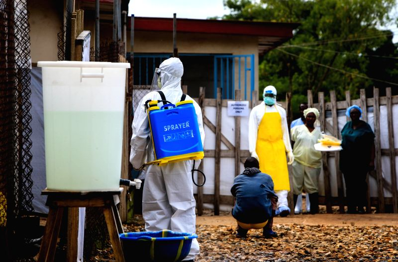 A medical worker is seen outside an Ebola treatment center at the government hospital in Kenema, east of Sierra Leone, Aug. 18, 2014. Sierra Leone's Minister of ...