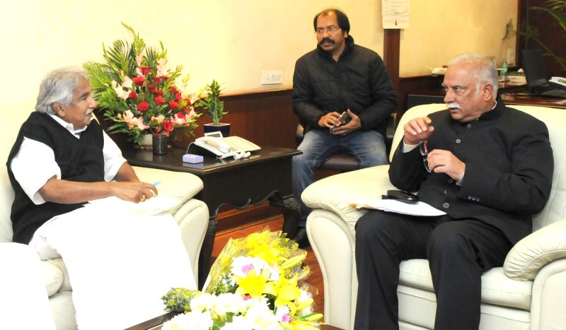 Kerala Chief Minister Oommen Chandy meets the Union Minister for Civil Aviation, Ashok Gajapathi Raju Pusapati, in New Delhi on Dec 11, 2015. - Oommen Chandy