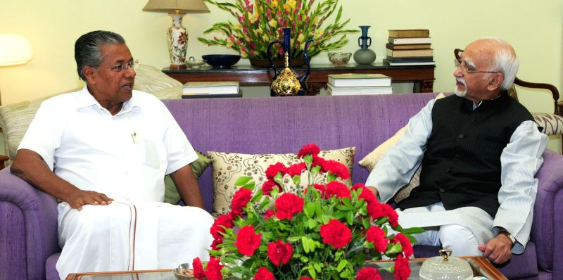 Kerala Chief Minister Pinarayi Vijayan calls on the Vice President M Hamid Ansari, in New Delhi on May 28, 2016. - Pinarayi Vijayan