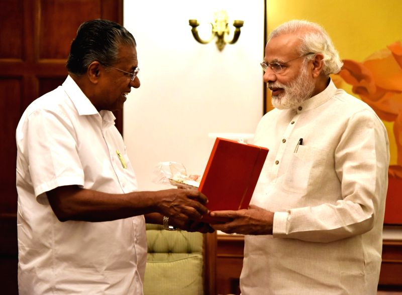 Kerala Chief Minister Pinarayi Vijayan calls on the Prime Minister Narendra Modi, in New Delhi, on May 28, 2016. - Pinarayi Vijayan and Narendra Modi