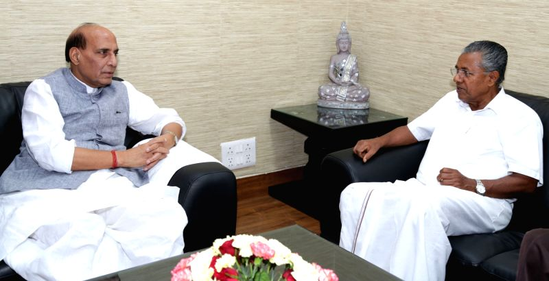 Kerala Chief Minister Pinarayi Vijayan calls on the Union Home Minister Rajnath Singh in New Delhi on May 28, 2016. - Pinarayi Vijayan and Rajnath Singh