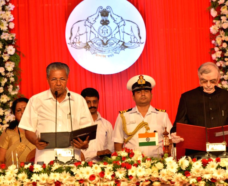 Kerala Governor Justice (Retd) P Sathasivam administers oath to CPI-M leader Pinarayi Vijayan as the chief minister of state in Thiruvananthapuram on May 25, 2016.