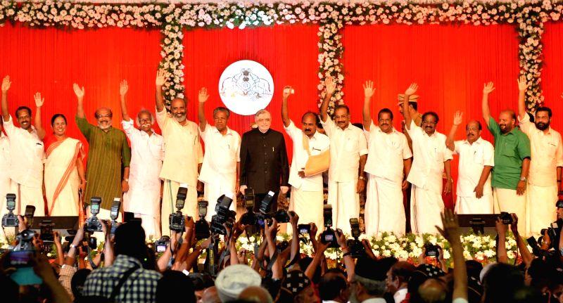 Kerala Governor Justice (Retd) P Sathasivam and Chief  Minister Pinarayi Vijayan during latters swearing-in ceremony in Thiruvananthapuram on May 25, 2016. - Pinarayi Vijayan