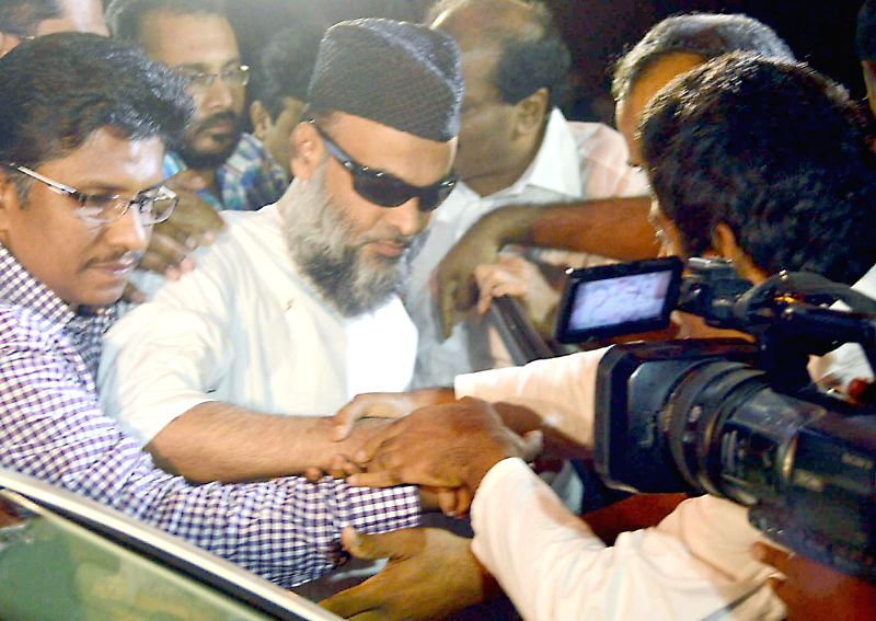 Kerala People Democratic Party Chairman Abdul Nasser Madani who was arrested in connection with 2008 Bangalore Serial blasts, after being released from Parappana Agrahara Central Jail on health ...