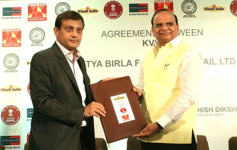 Khadi & Village Industries Commission Chairman Vinai Kumar Saxena and Aditya Birla Fashion and Retail Ltd Business Head Ashish Dikshit during a programme organised to announce ... - Vinai Kumar Saxena