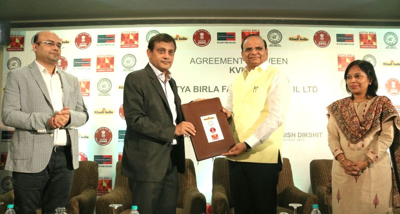 Khadi & Village Industries Commission (KVIC) Chairman Vinai Kumar Saxena, Financial Advisor Usha Suresh and Aditya Birla Fashion and Retail Ltd Business Head Ashish Dikshit during a ... - Vinai Kumar Saxena