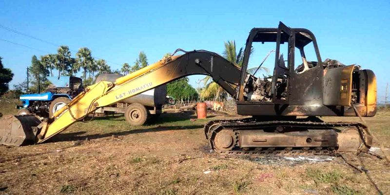 An earth mover that was allegedly destroyed by Maoists along with other vehicles being used for road construction, in Khammam district of Telangana on Jan 6, 2015.