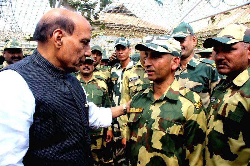 Union Home Minister Rajnath Singh interacts with soldiers during his visit the border (Indo-Bangladesh) areas in Khantlang of Tripura on Feb 14, 2015.