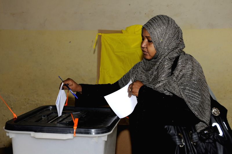A woman casts her vote at a polling station in Khartoum, Sudan, April 13, 2015. Voters in Sudan started casting their votes on Monday to elect a president and ...