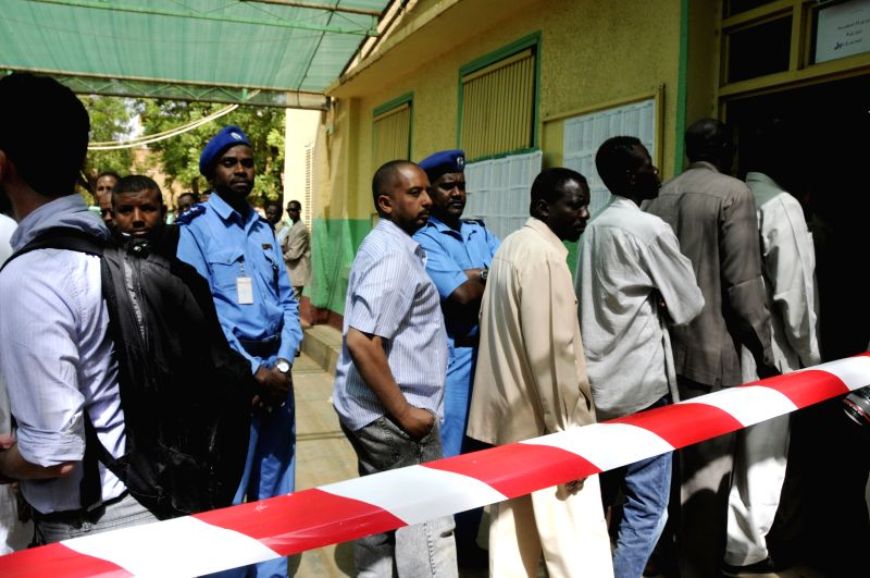 People prepare to cast their votes at a polling station in Khartoum, Sudan, April 13, 2015. Voters in Sudan started casting their votes on Monday to elect a ...