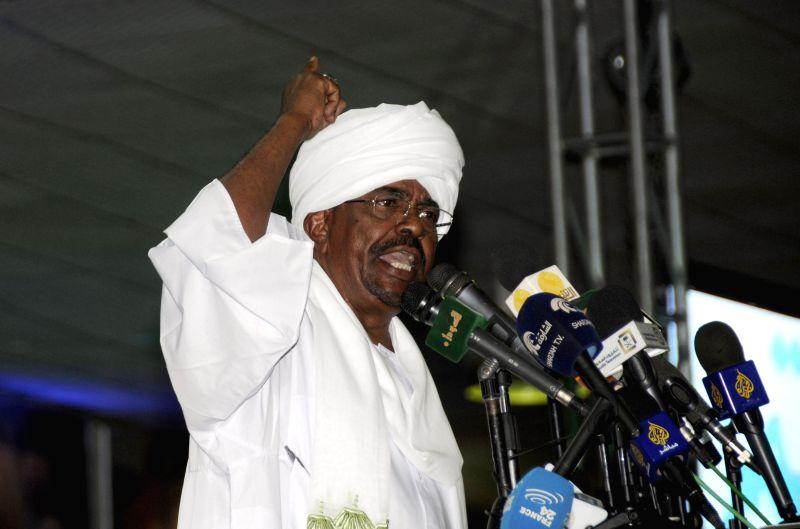 Sudanese President Omar al-Bashir speaks at the headquarters of the ruling National Congress Party in Khartoum, Sudan, April 27, 2015. Sudanese President Omar ...