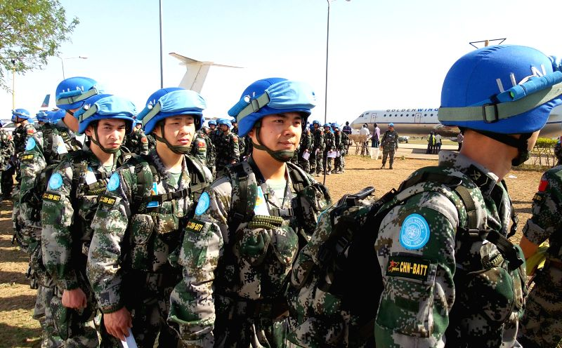 Chinese soldiers arrive at Juba airport in South Sudan, on April 8, 2015. The last batch of the Chinese peacekeeping infantry battalion arrived in South Sudan on ...