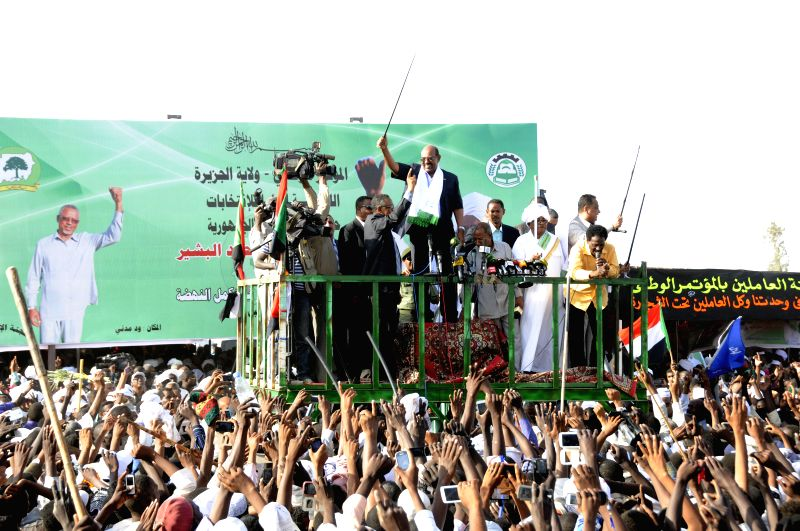 Sudanese President Omar al-Bashir waves towards supporters during an electoral campaign in Medani city, Sudan, on Feb. 26, 2015. Sudanese President Omar al-Bashir ...
