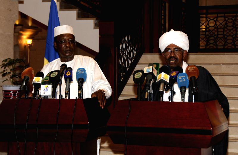 Sudanese President Omar al-Bashir (R) and his Chadian counterpart Idriss Deby attend a press conference after their meeting in Khartoum, Sudan, Jan. 28, 2015. ...