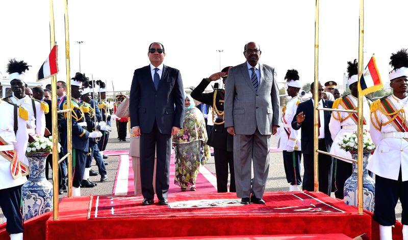 KHARTOUM, July 19, 2018 - Egyptian President Abdel-Fattah al-Sisi (L, center) and Sudanese President Omar al-Bashir (R, center) attend a welcome ceremony in Khartoum, Sudan, on July 19, 2018. ...