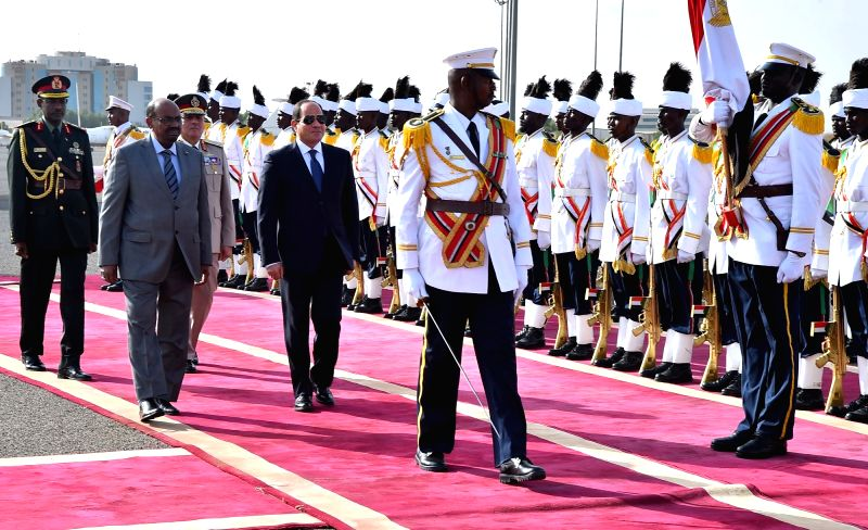 KHARTOUM, July 19, 2018 - Egyptian President Abdel-Fattah al-Sisi (4th L, front) and Sudanese President Omar al-Bashir (2nd L, front) inspect the guard of honor during a welcome ceremony in Khartoum, ...