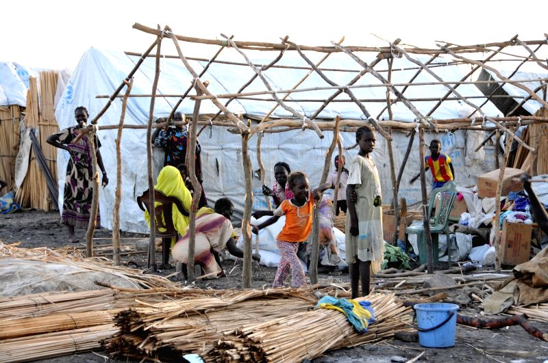 KHARTOUM, May 18, 2017 - Refugees from South Sudan build a tent at a refugee camp in Sudan's White Nile state near the border with South Sudan on May 17, 2017. The Sudanese Red Crescent Society ...