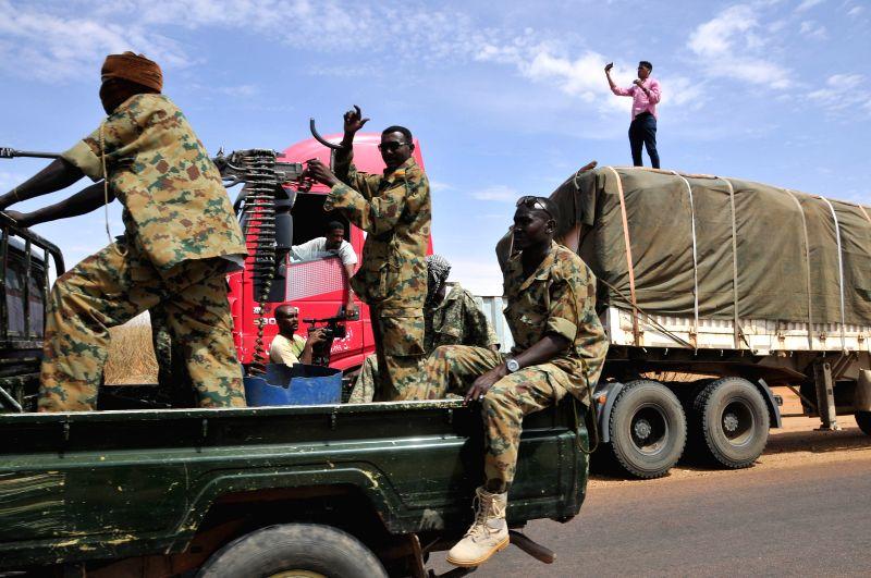 KHARTOUM, May 20, 2017 - Security members escort the convoys carrying food materials through the humanitarian corridor from Sudan's El Obied to Bentiu in Bahr el Ghazal State of South Soudan, May 19, ...
