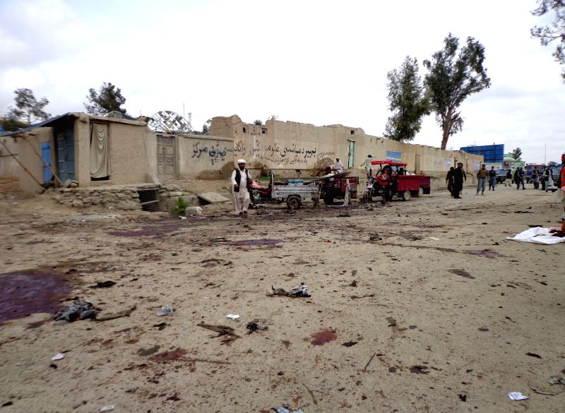 Afghan security forces inspect the site of suicide bombing in Khost province in southeast Afghanistan on April 2, 2015. A suicide bombing rocked Khost city, the ...