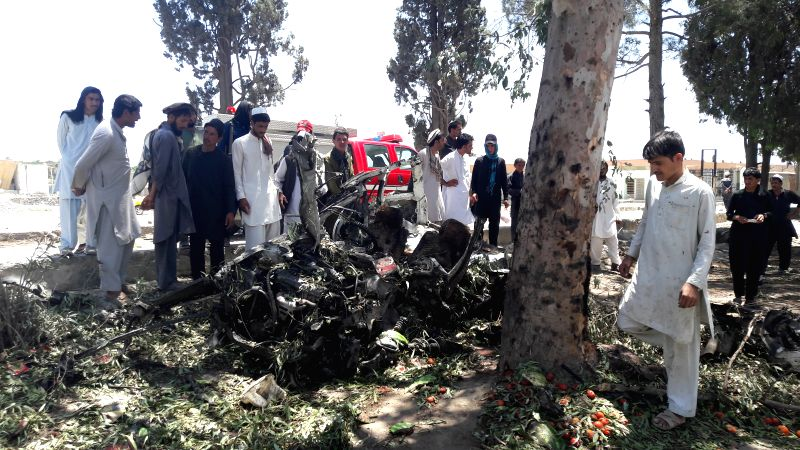 KHOST, May 27, 2017 - Some civilians inspect the blast site in Khost city, eastern Afghanistan on May 27, 2017. At least 18 persons were killed Saturday when a suicide car bombing struck a crowded ...