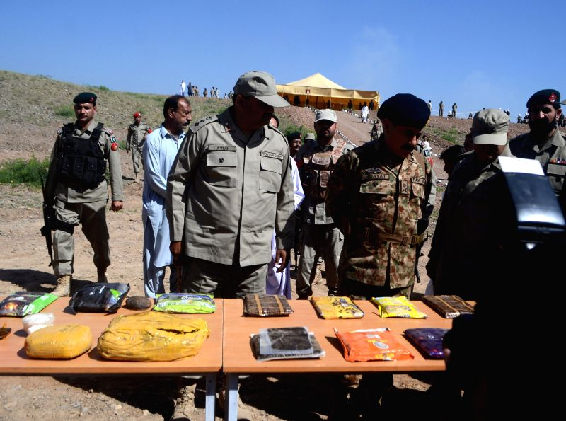 Pakistani anti-narcotics officials display seized drugs in northwest Pakistan's Khyber Agency on April 23, 2015. About 40,000 kg of drugs including heroin, ...