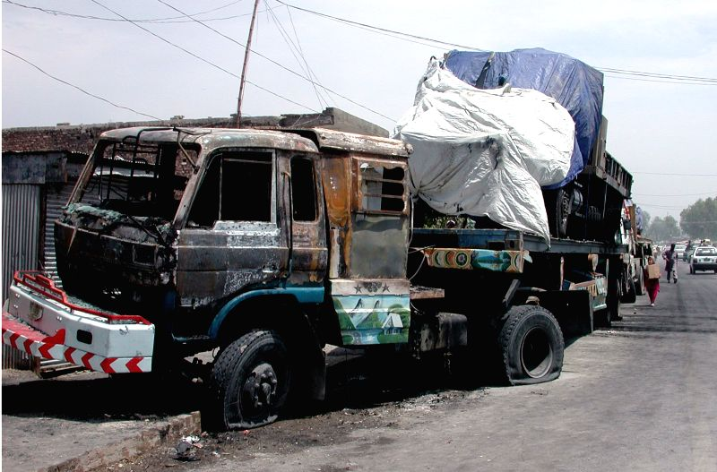 Photo taken on May 5, 2014 shows a damaged truck used by NATO for supplies transportation in northwest Pakistan's Khyber Agency on May 5, 2014. At least three ..