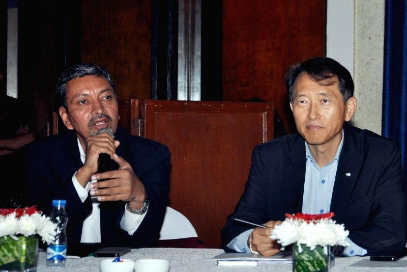 KIA Motors India Head (sales and marketing) Manohar Bhat and KIA Motors India Executive Director Yong S Kim address a press conference, in Kolkata on July 26, 2018.