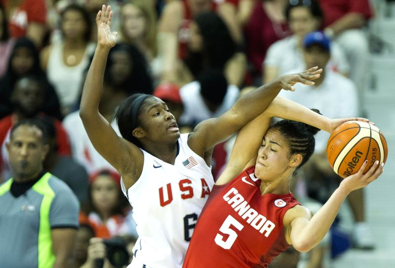 Kia Nurse(R) of Canada vies with Linnae Harper of the United States during their women's final match of the basketball event at the 17th Pan American Games in ...