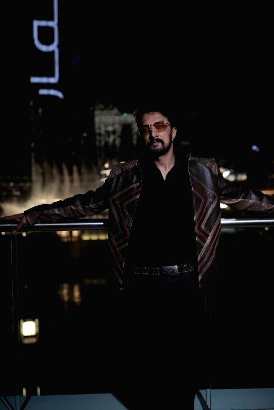 Kichcha Sudeepa toasts 25 years in films at Burj Khalifa, launches title  of latest