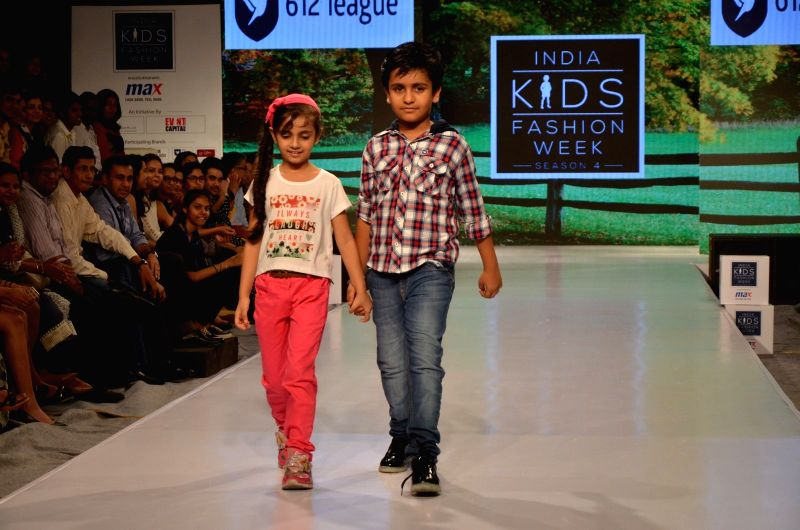 Kids walk the ramp during India Kids Fashion Week 2016, in Mumbai on June 03, 2016.
