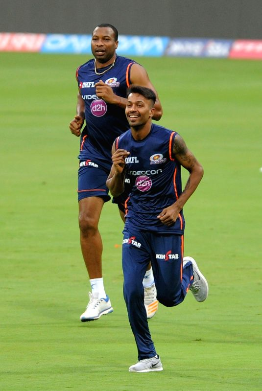 Kieron Pollard and Hardik Pandya of Mumbai Indians during a practice session at Chinnaswamy Stadium in Bengaluru on May 18, 2017.