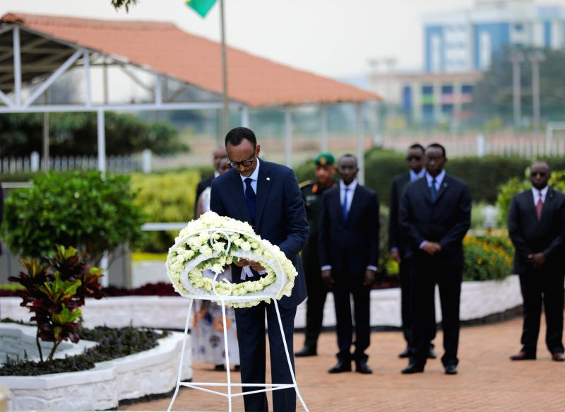 KIGALI, Feb. 1, 2018 - Rwandan President Paul Kagame (front) lays a wreath at the heroes' mausoleum in Remera Sector, Kigali, Rwanda, on Feb. 1, 2018. Rwanda on Thursday marked National Heroes' Day ...