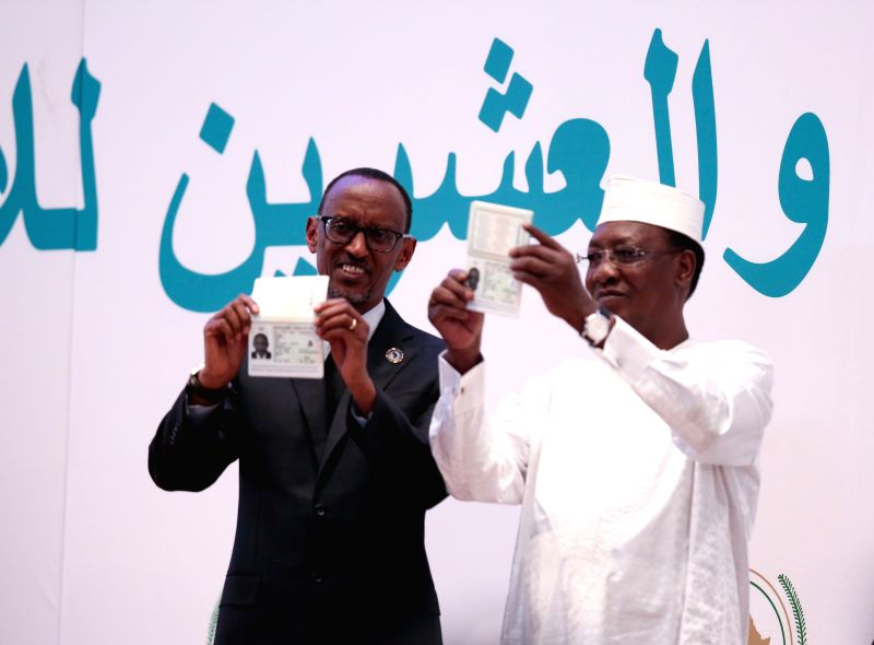 KIGALI, July 18, 2016 - Rotating African Union chairperson Idriss Deby (R), President of the Republic of Chad, and President of Rwanda Paul Kagame show their e-passports at the opening ceremony of ...